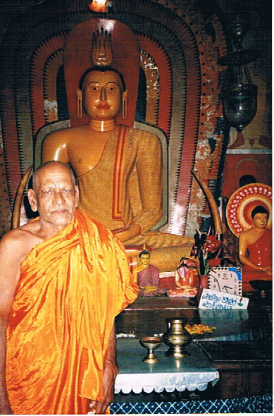 Monk with Buddha statue
